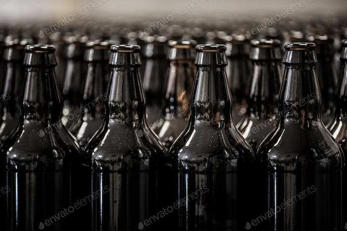 Brown glass bottles rows