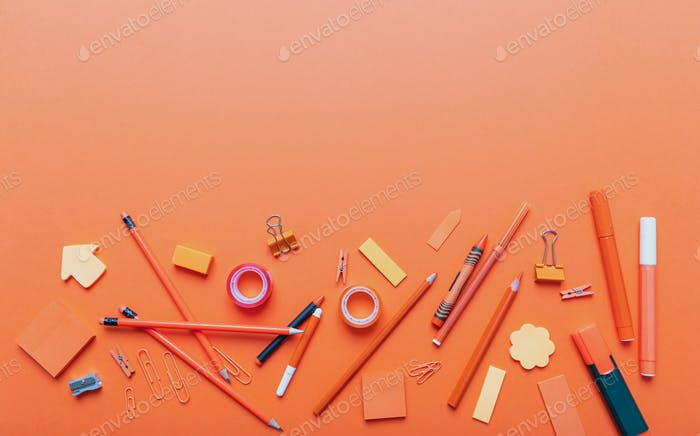 Flat lay of office, school stationery on orange color background