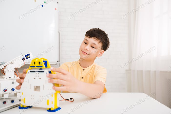 Stem lesson. Clever boy constructing electronic toy