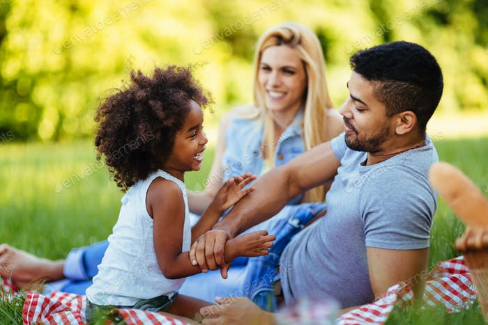 Happy family having fun time on picnic