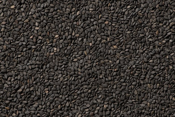Black sesame seeds close up background