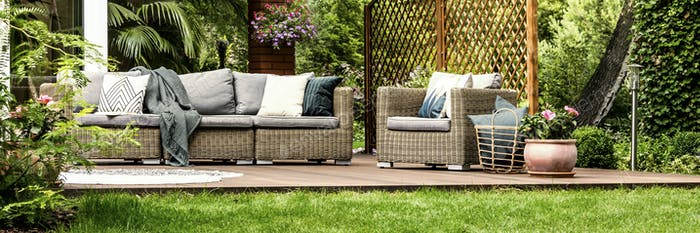 Sofa and armchair on terrace