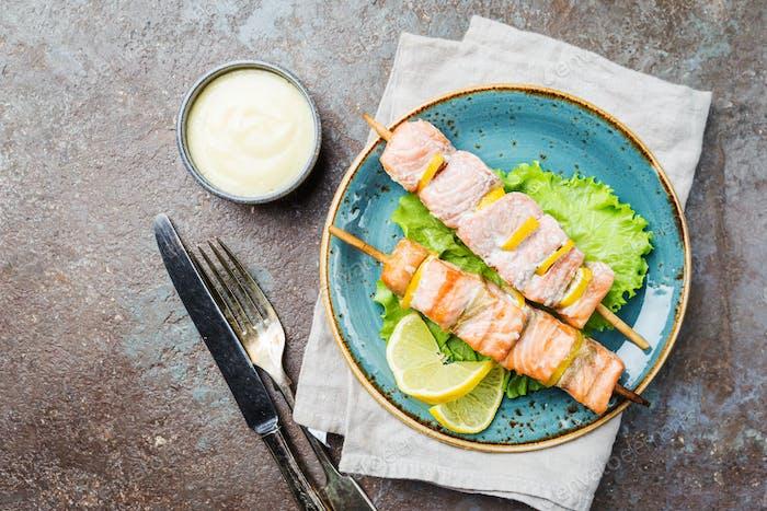 Grilled skewers of salmon
