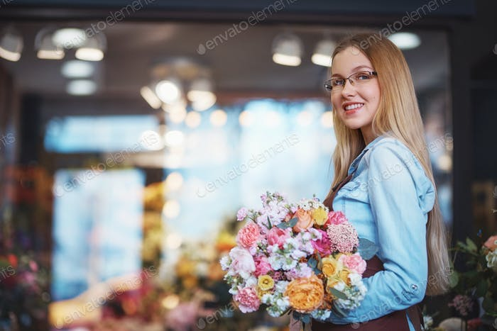 Smiling woman with a bouquet of flowers
