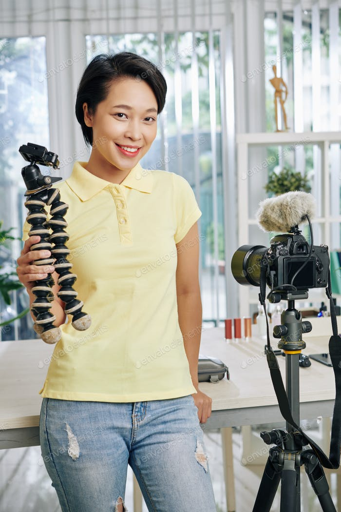 Female blogger with tripod