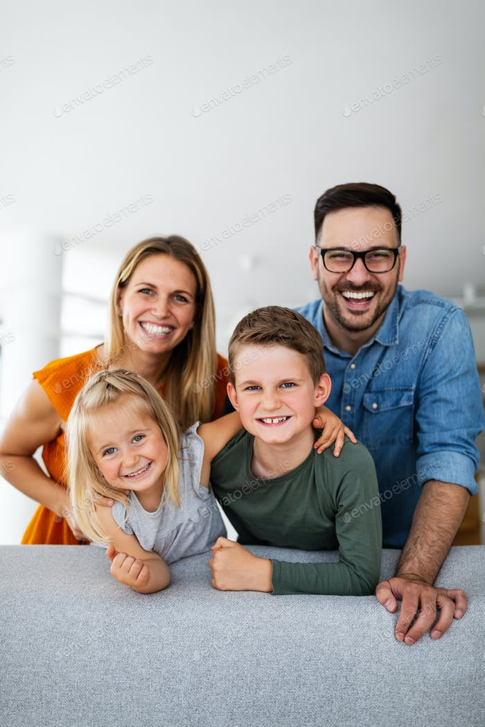 Portrait of happy smiling family at home