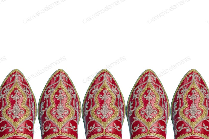 Red leather Moroccan style shoes isolated
