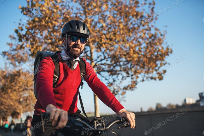 Hipster businessman commuter with bicycle traveling to work in city.