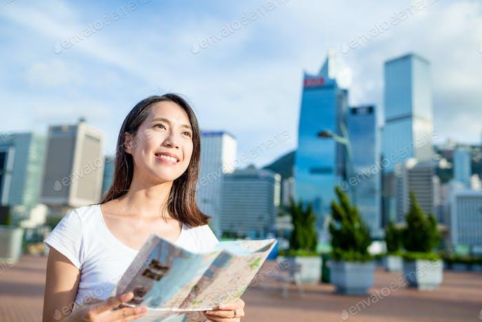 Woman using city map in Hong Kong