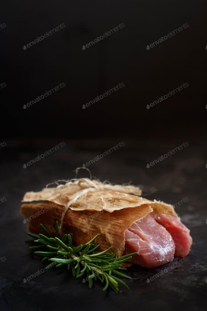 Slice of raw turkey steak with rosemary