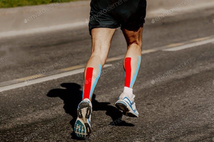 legs runner with kinesio tape