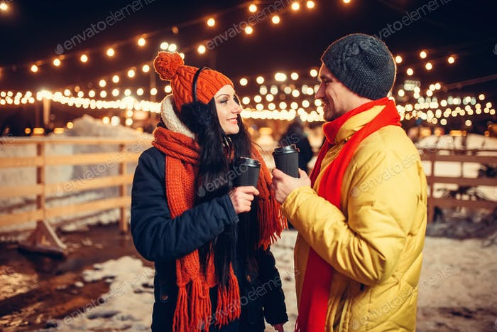 Winter evening, love couple walking outdoors