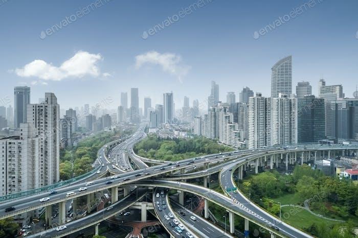 city interchange in shanghai, elevated road junction and bule sky