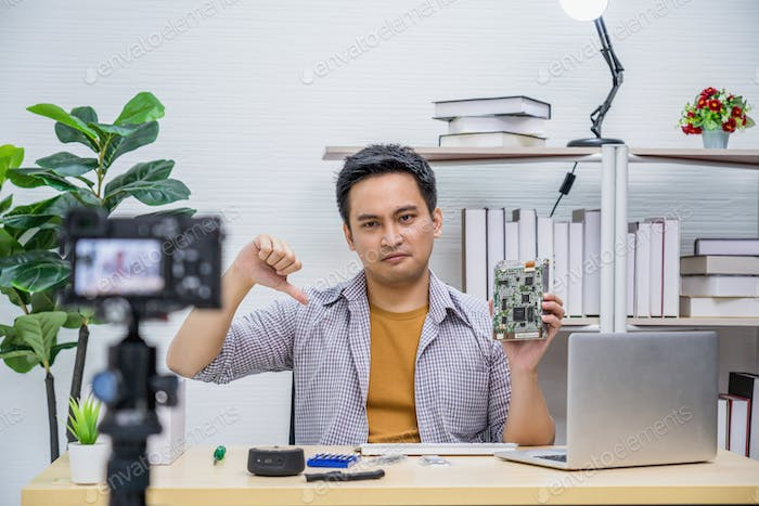 Asian Vlogger man dissatisfied old technology of hard disk when sharing knowledge