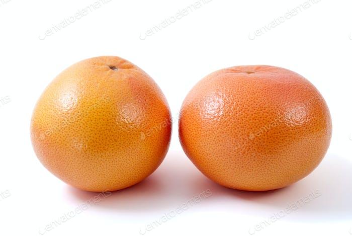 Two orange grapefruits