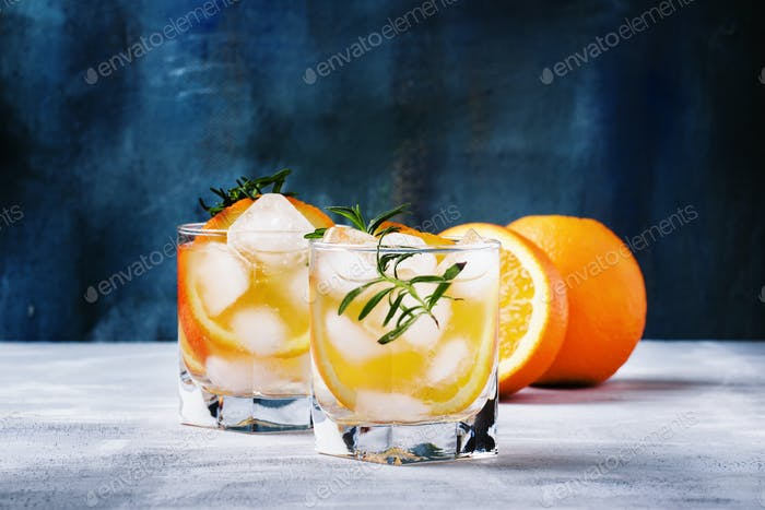 Refreshing drink with orange, rosemary and ice