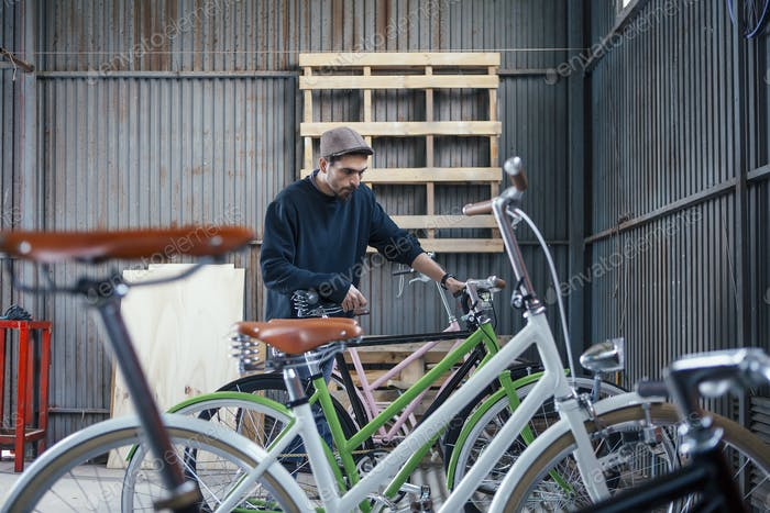 Craftsman looking at bicycles