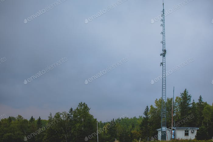 Telecom Worker Climbing Antenna Tower