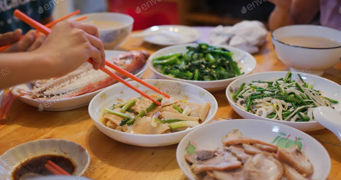 Hong Kong style home cuisine, family dinner concept, steamed fish, fry vegetable and meat