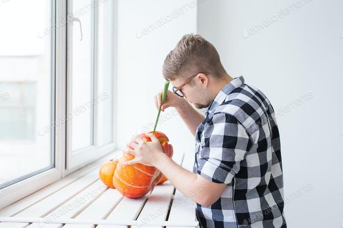Hollowing out a pumpkin to prepare halloween lantern.