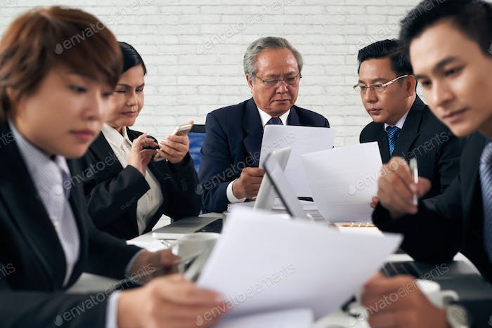 Lawyers working with papers