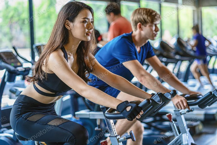 Couple young diversity working out in gym fitness sport complex, workout working out
