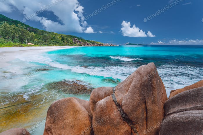 Grand Anse at La Digue island in Seychelles. Long exotic paradise like beach with blue lagoon and