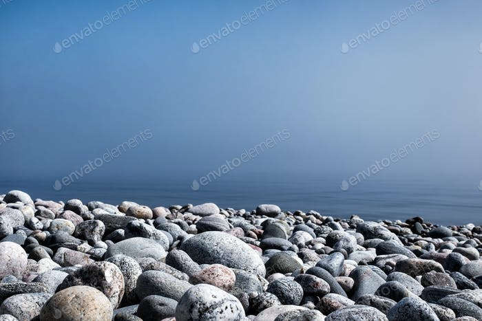 Rocks on beach of Ladoga lake in Russia