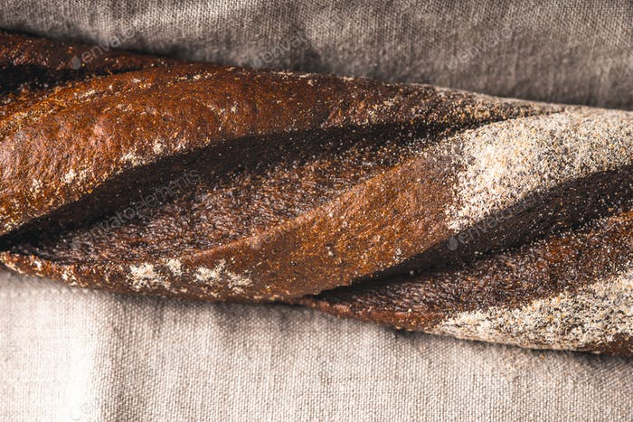 Baguette on the grey napkin horizontal