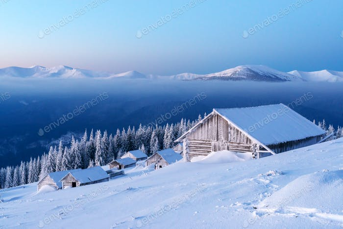 Snowy cabin in the winter mountains