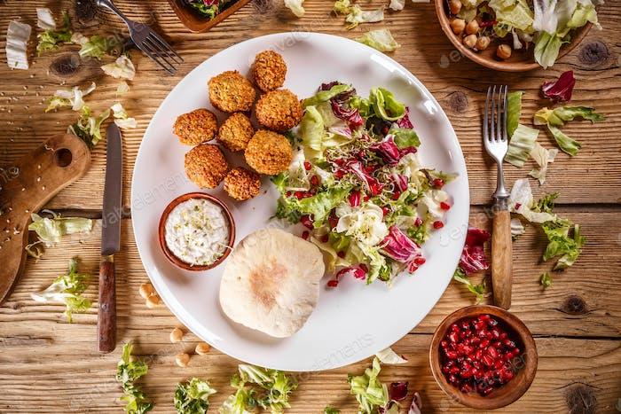 Falafel, deep fried balls of ground chickpeas