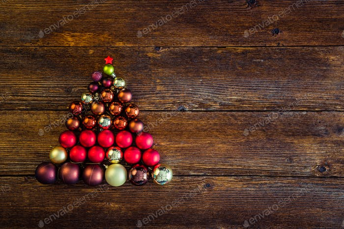 Christmas tree shaped design made from Christmas balls. Space for text