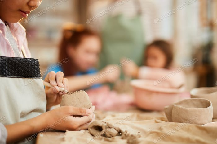Little Girl Shaping Clay