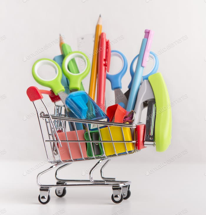 Close up of shopping cart with purchases from stationery shop