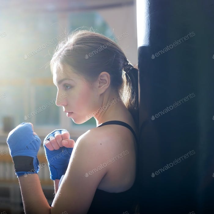 Young adult sexy boxing girl posing with gloves.