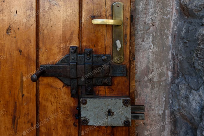 Elements of architectural decoration of ancient buildings, an old metal forged door