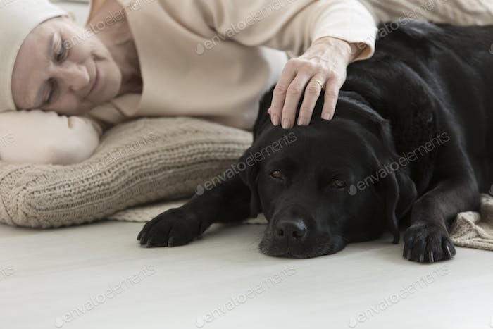 Sick woman sleeping with dog