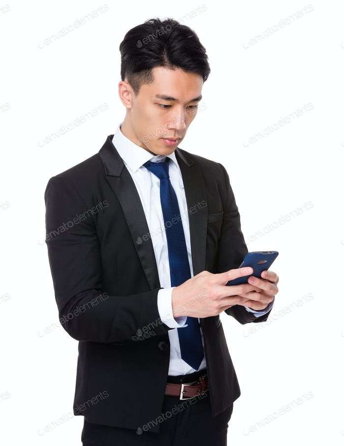 Young businessman check the email on cellphone
