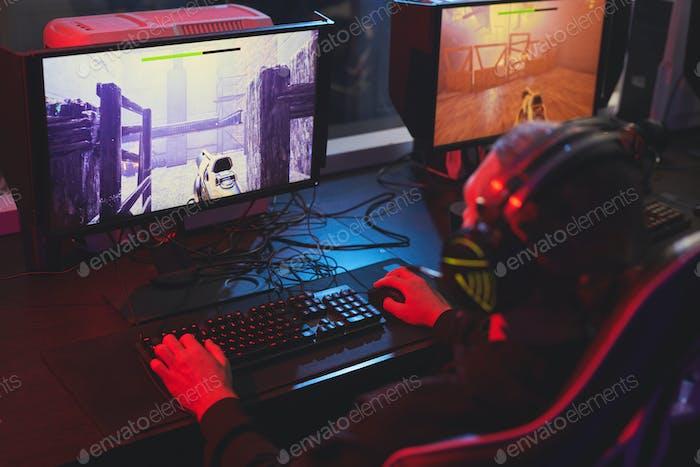 Playing arcade shooting game