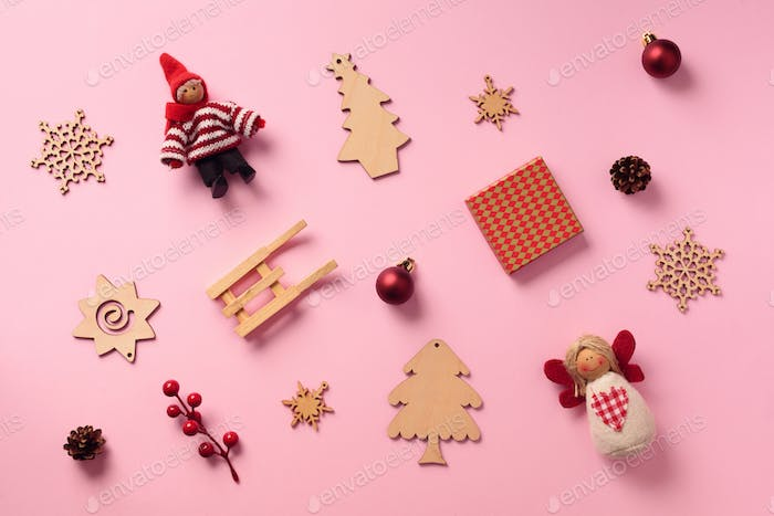 Greeting card for New year party. Christmas gifts, decorative elements and ornaments on pink