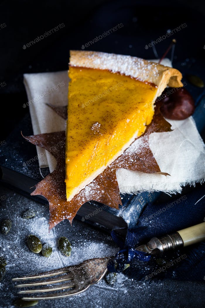A Slice of Thanksgiving Pumpkin Pie in Autumn Scene