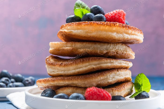 Pile of Pancakes Crepes Served with Fresh Fruits. Shrove Tuesday