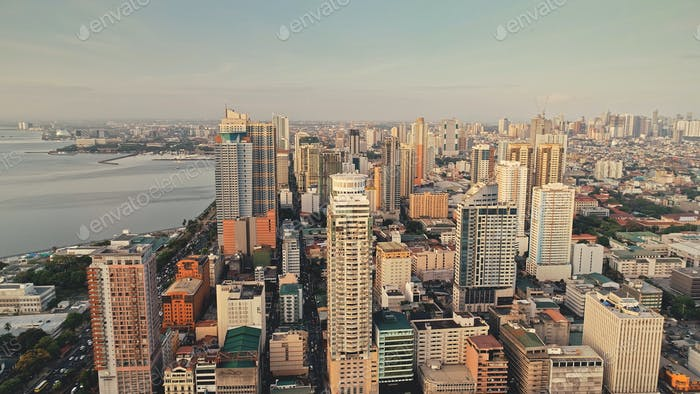 Tropic city cityscape with modern buildings and skyscrapers aerial. Philippines metropolis town