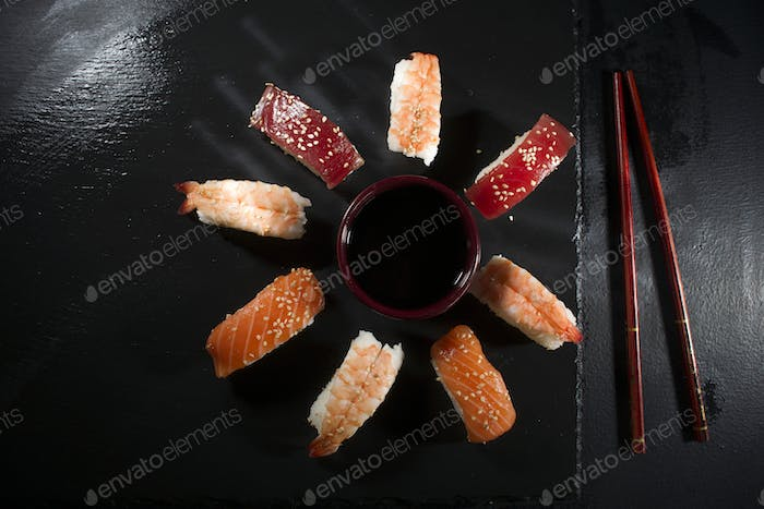 Circular sushi plate with chopsticks