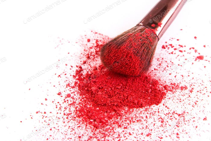 Makeup brush background with blush sprinkled on white