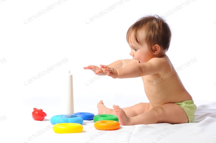 Surprised funny baby playing with toy
