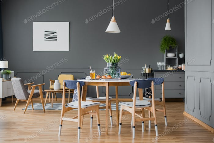 Table in grey room interior