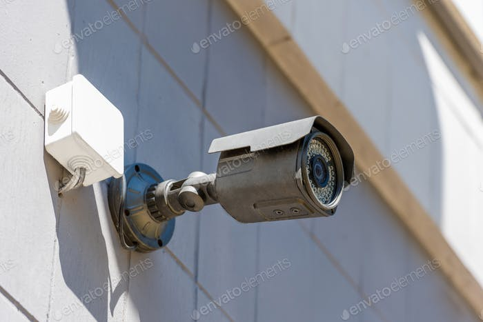 close up of security camera on wall, security system concept