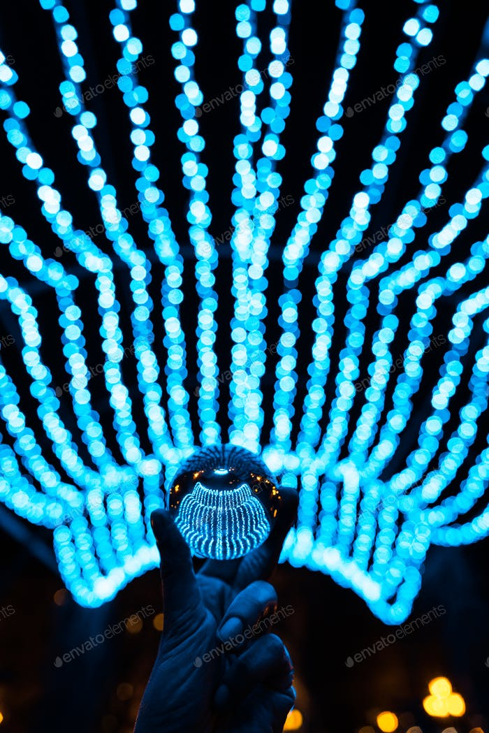 crystal ball stay in blue garland lights