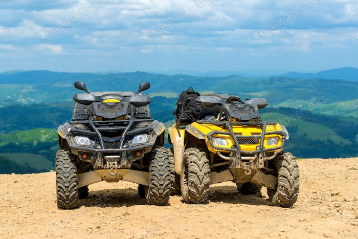 ATV Quad Bike in front of mountains landscape
